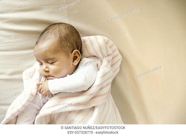 Cute Baby Girl sleeping in the Crib. At home