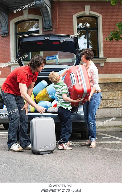 Germany, Leipzig, Family loading luggage into car