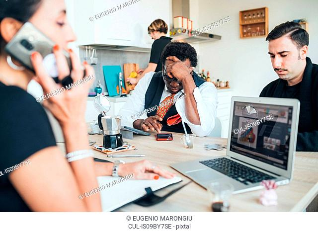 Businessmen and businesswoman using smartphone in loft office