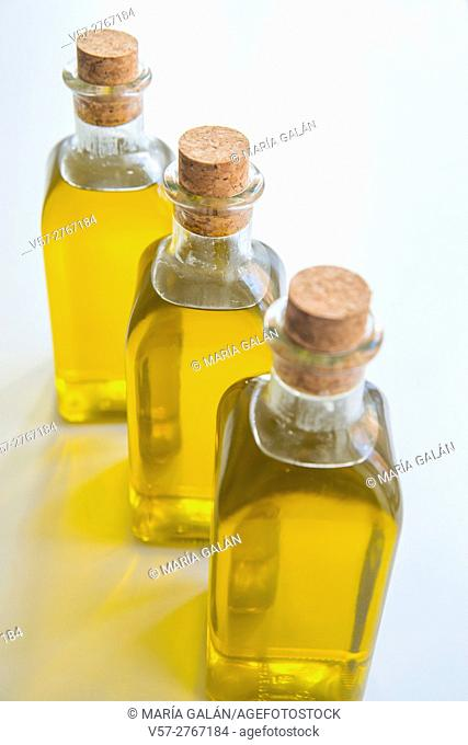 Three olive oil bottles