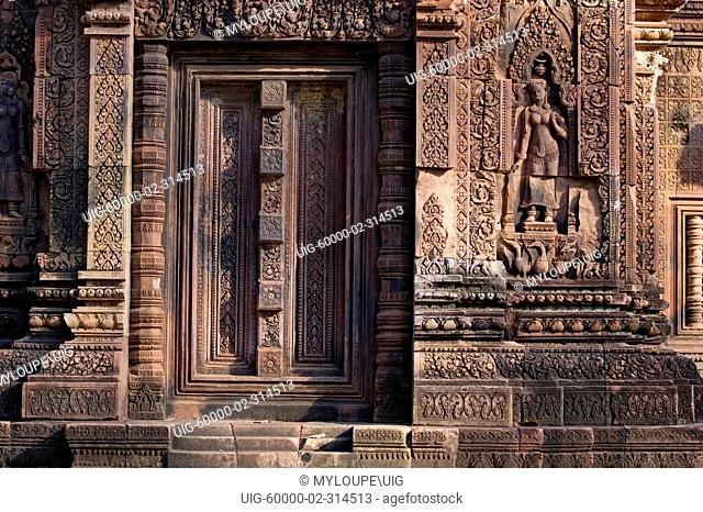Hindu temple door with Apsara celestial maiden at Banteay Srei, 10th century Khmer architecture at Angkor Wat - Siem Reap, Cambodia