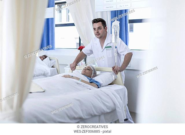 Nurses moving patient lying in bed