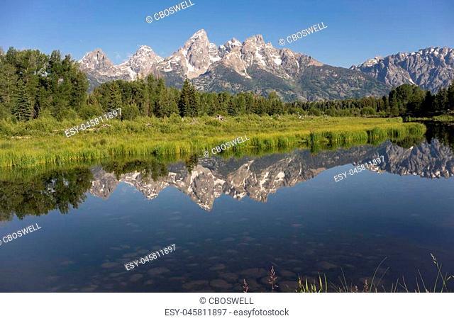 Rocky Mountain Range Reflected Smooth Water Grand Teton National Park