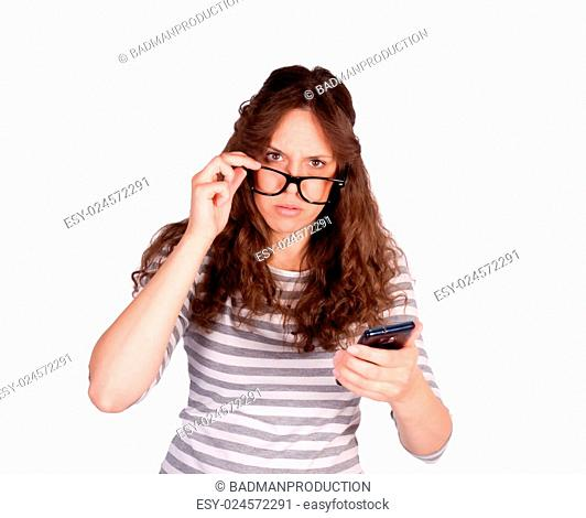 Confused women with cell phone in her hands isolated on white background