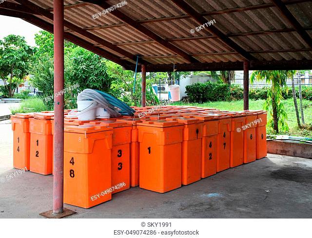 Group of large orange plastic tank