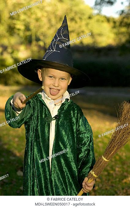 A 4 year old boy dressed up as a wizard for Halloween
