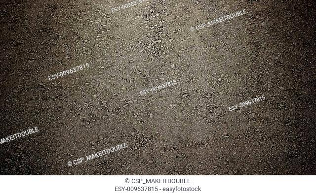 black asphalt with vignette for background or texture