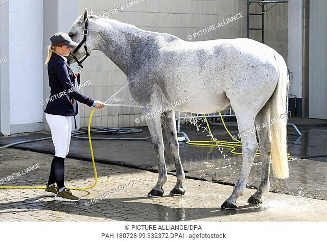 28 July 2018, Germany, Berlin, Equestrian sports/jumping, Global Champions Tour (Small Tour): Luna Marie Schweiger and her horse Koude after jumping in the...