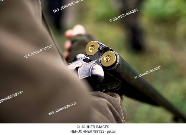 A sportsman with a shot-gun, close-up, Sweden