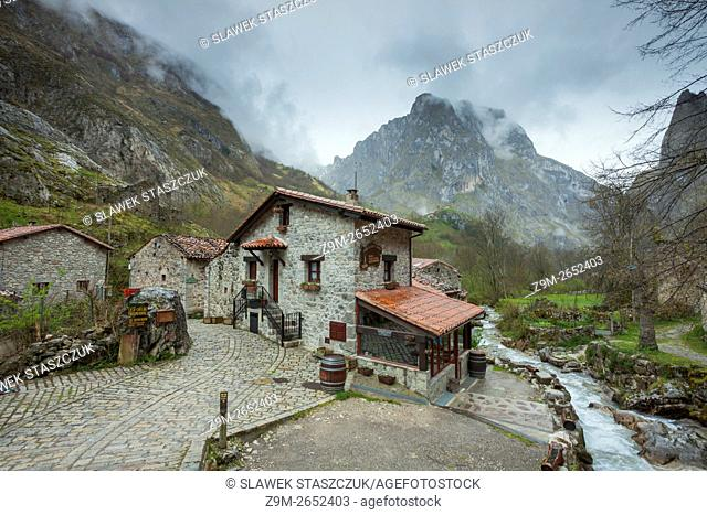 Misty mountains tower over Bulnes, Picos de Europa National Park, Asturias, Spain