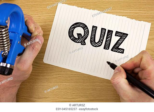Text sign showing Quiz. Conceptual photo Short Tests Evaluation Examination to quantify your knowledge written by Man Tear Notebook paper Marker and Tool in...