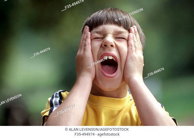 Headshot of boy having a temper tantrum