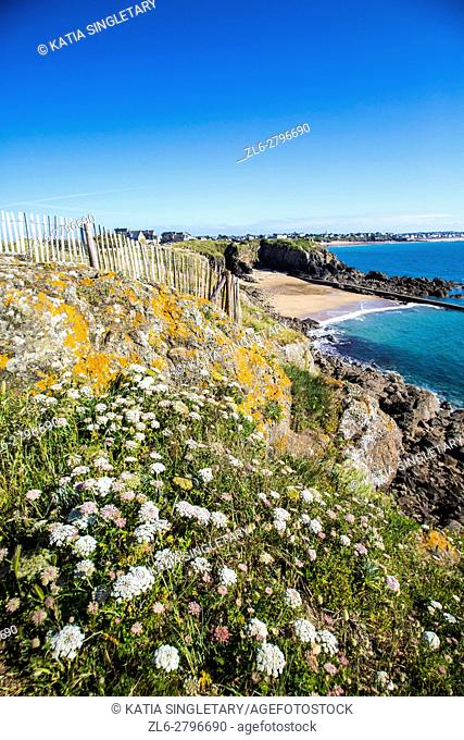La Pointe de La Varde on the blue ocean in Saint Malo, France. This beautiful ''crique of sand'' with the exeptional environnement of dunes