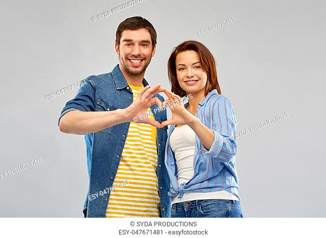 happy couple making hand heart