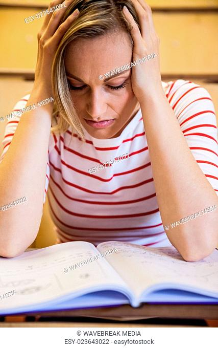 Busy female student studying