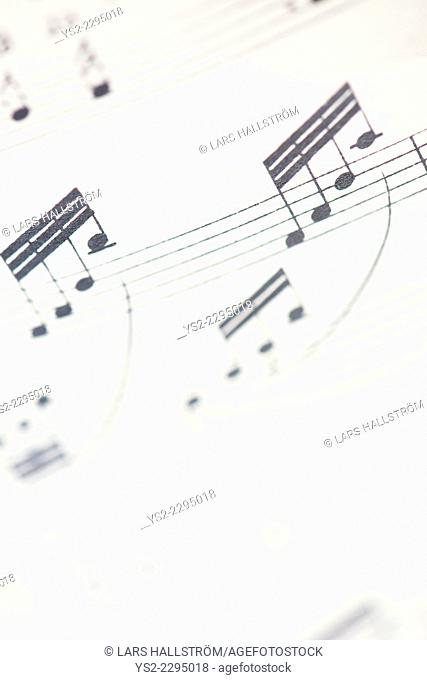 Close up of musical notes on paper