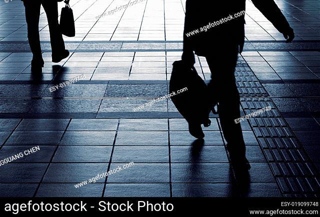 Businessman silhouette carry briefcase