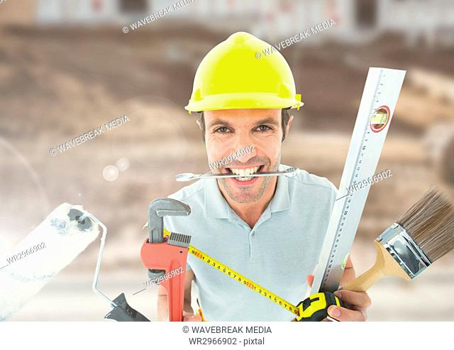 Construction Worker with tools in front of construction site