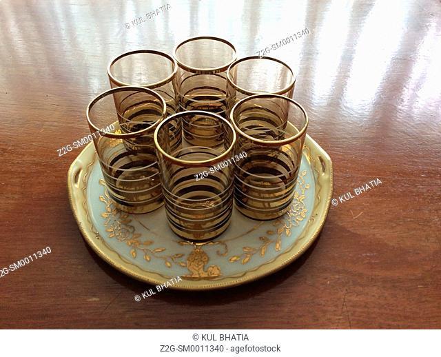 Six elegant glasses on an ornate plate, Canada