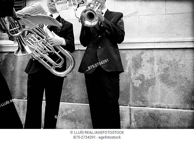 Two unrecognizable musicians with a trumpet and a tuba performing in the street during Holy Week celebrations, Mahon, Menorca, Baleares, Spain