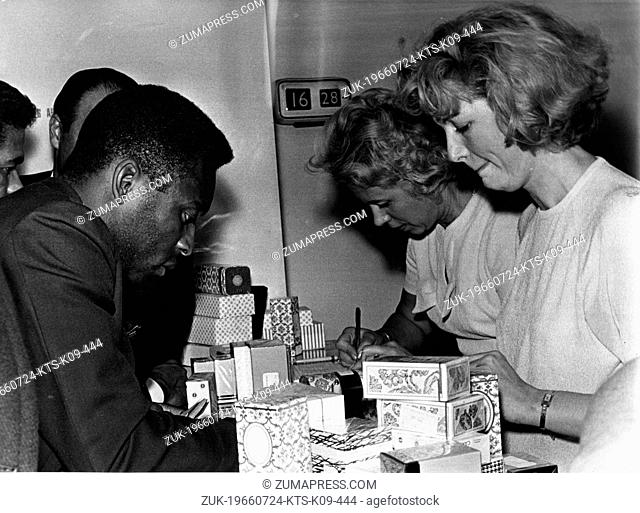 July 24, 1966 - London, England, U.K. - Brazilian soccer player EDSON NASCIMENTO 'PELE' buying gifts at the London Airport during a long delay on the arrival of...
