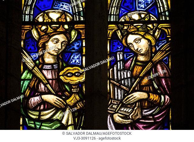 Detail stained glass window of santa lucia and santa cecilia, church santa maria dels turers, location banyoles, Girona, Catalonia, Spain