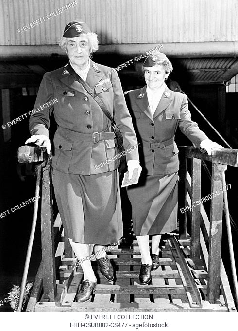 Anne Tracy Morgan and Mrs. W. R. Heberhart boarding the French liner Oregon. June 23, 1945. They were sailing for France in connection with Anne Morgan's...