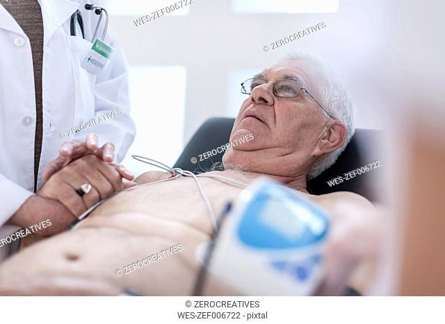 Senior man doing chek up in hospital, looking worried