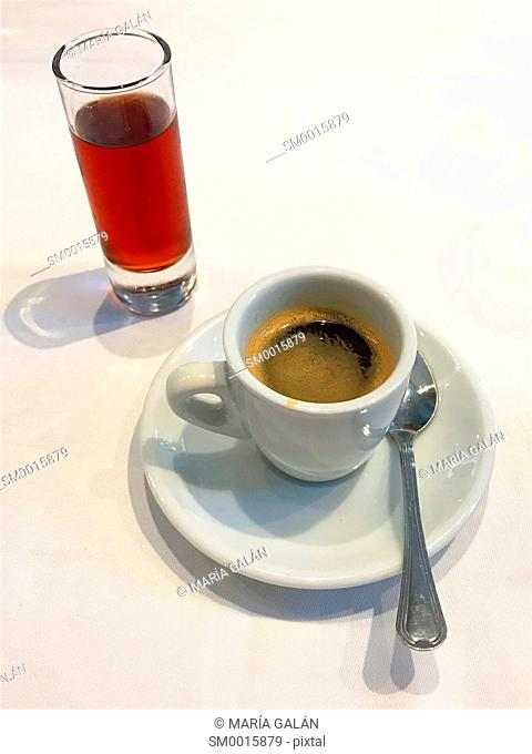 Cup of coffee and glass of liqueur