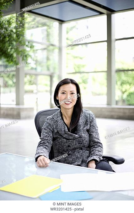 Portrait of an Asian businesswoman in the lobby of a convention centre
