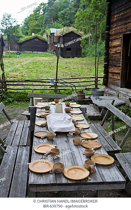 Historic table setting with wooden tableware in the Norsk Folkemuseum (Norwegian Museum of Cultural History), Bygdøy, Oslo, Norway, Scandinavia, Europe