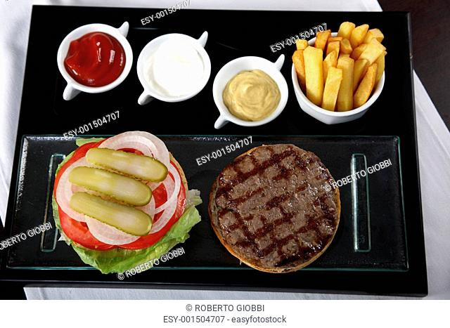 Burger french fries and sauces from top view