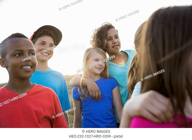 Schoolchildren looking away during field trip