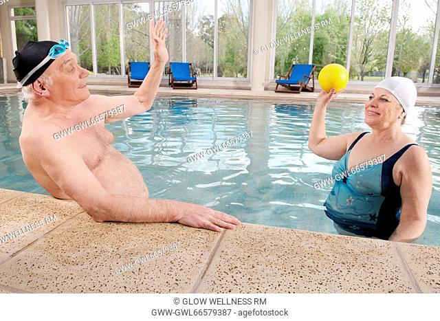 Couple playing in a swimming pool
