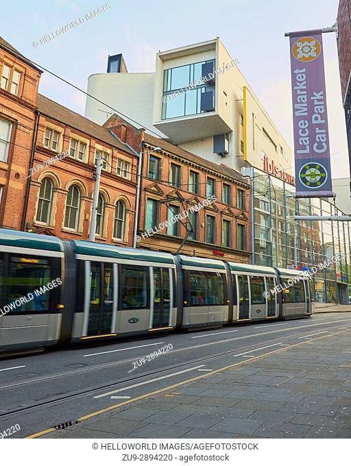 Tram passing The Pod by Benson and Forsyth, Ibis hotel, Fletcher Gate, Nottingham, Nottinghamshire, east Midlands, England