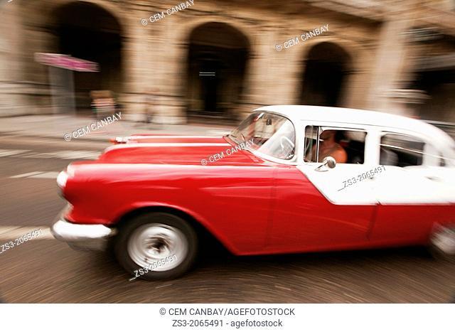 Dynamic scene of an old american car, Prado, Havana, Cuba, West Indies, Central America