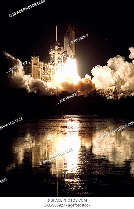 11/30/2000 -- Nearby waters capture the brilliance of Space Shuttle Endeavour's flames as it leaps off Launch Pad 39B toward space