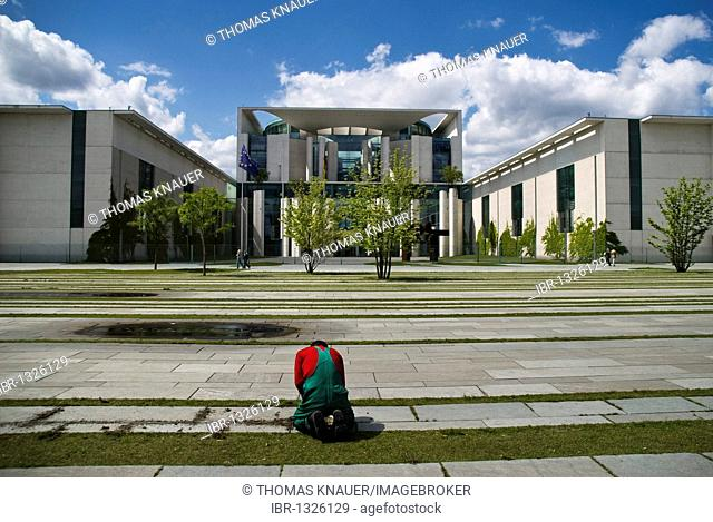 Worker maintaining the front lawn of the Federal Chancellery, Berlin, Germany, Europe