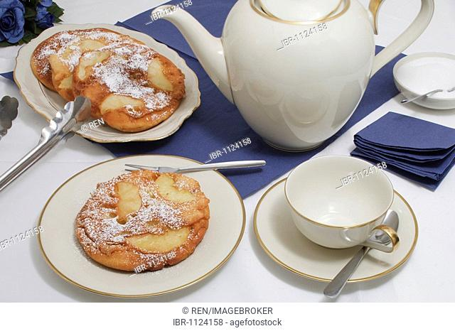 Apple pancake with icing sugar, coffee pot, sugar, coffee cup