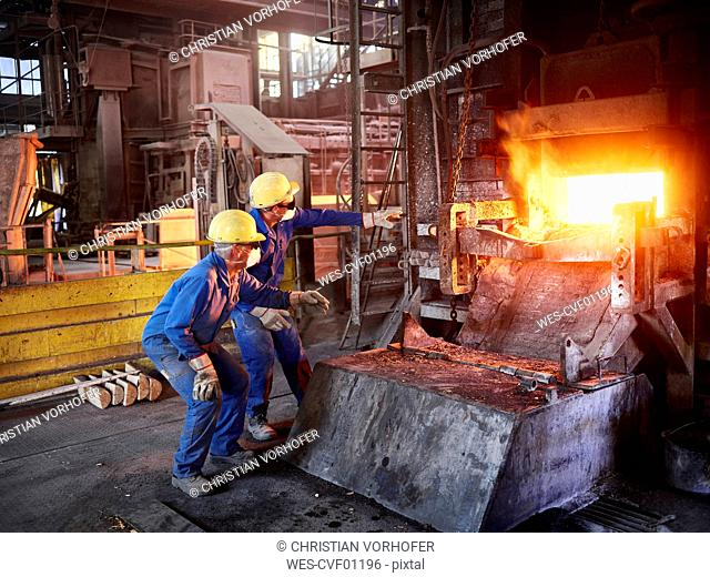 Industry, Smeltery: Workers checking blast furnace for fractures