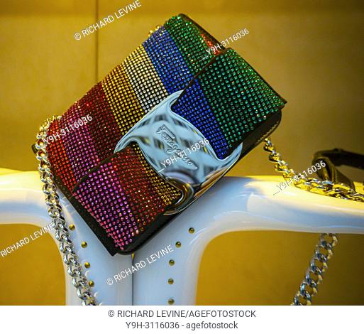 A rainbow pride themed handbag in the window of the Salvatore Ferragamo store on Fifth Avenue in New York on Tuesday, June 19, 2018