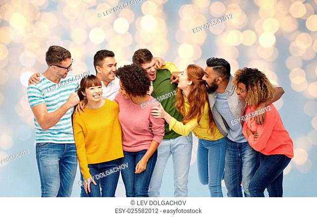diversity, race, ethnicity and people concept - international group of happy men and women laughing over holidays lights background