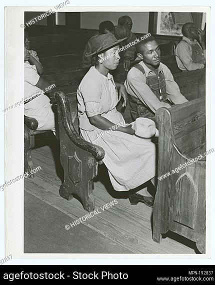 At a meeting of Negro FSA borrowers in a church near Woodville, Greene County, Georgia, May 1941. Additional title: [African Americans sitting in pews at a...