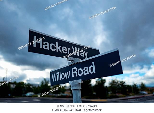 Road sign for Hacker Way and Willow Road, at the headquarters of social network company Facebook in Silicon Valley, Menlo Park, California, November 10, 2017