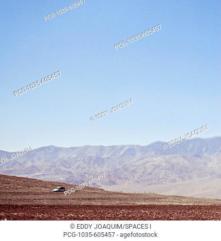 Automobile Driving Through Desert