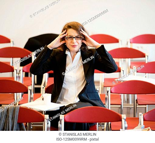 businesswoman stressed out after meeting