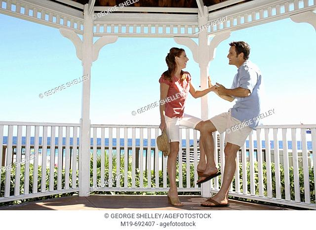 Couple holding hands in a Gazebo