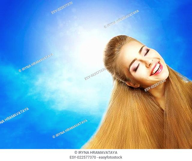 Positive Emotions. Portrait of Laughing Teen Girl over Sunny Blue Sky. Jubilance