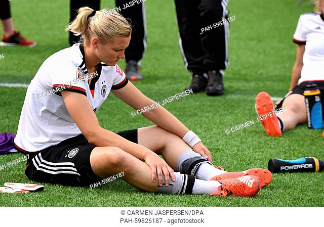 Germany's Alexandra Popp sit on the pitch after the FIFA Women's World Cup 2015 third place soccer match between England and Germany at the Commonwealth Stadium...