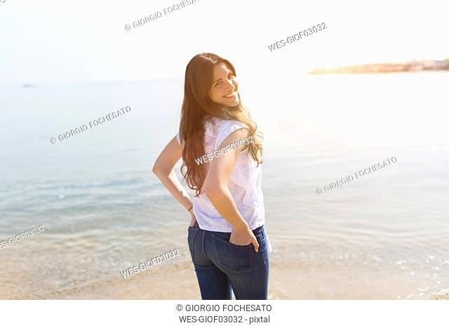 Portrait of beautiful young woman at the sea